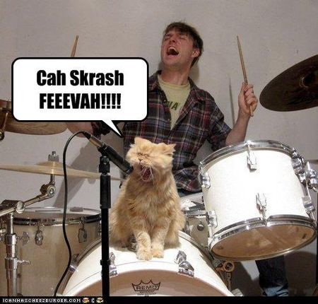 Funny-pictures-cat-sings-into-microphone